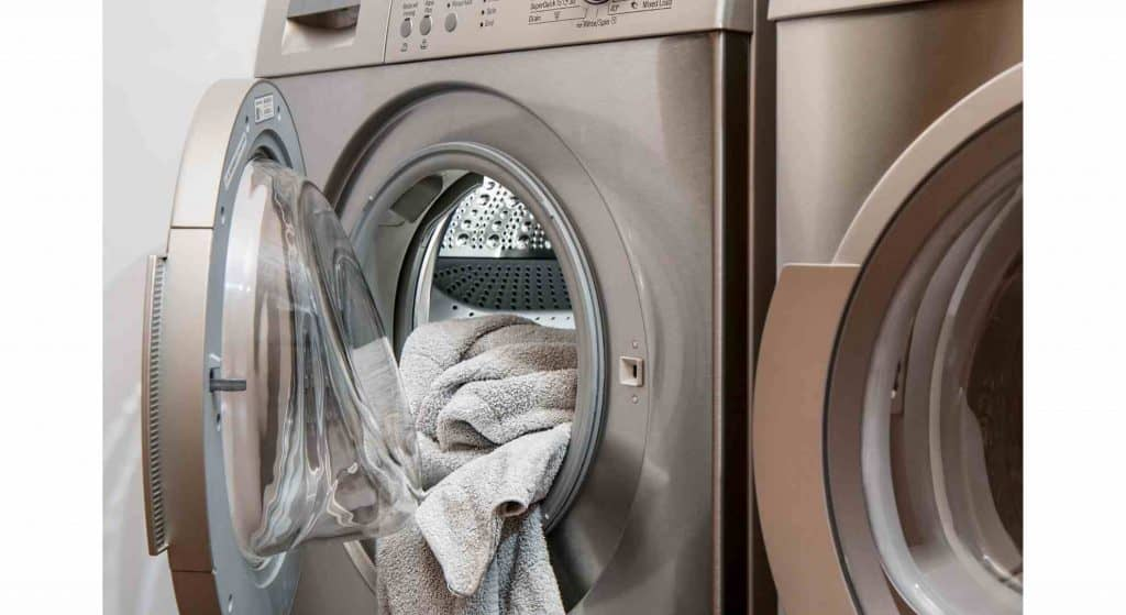Place your linens in the washer before you begin to clean your house.
