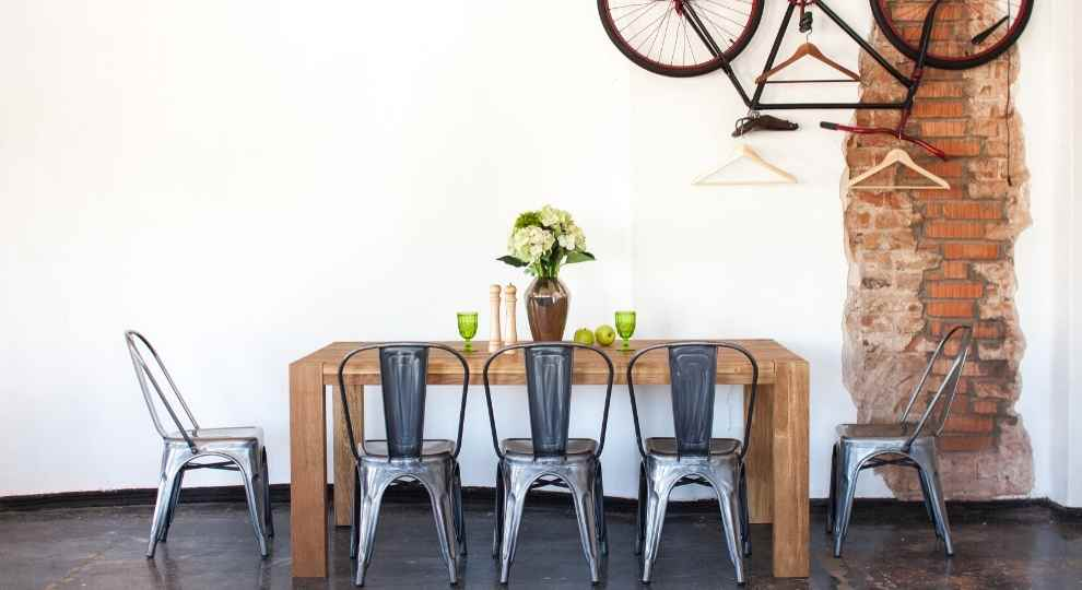 Modern farmhouse decor bistro chairs in gun metal color.